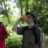 Author drinks coconut milk in rebel base at SIerra Leone
